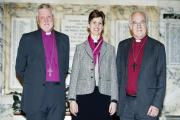 HISTORY: Bishop of Birkenhead, Rt Revd Keith Sinclair; Libby Lane; and The Bishop of Chester, The Rt Rev Dr Peter Forste inside Stockport town hall after the announcement that she will be appointed as the first female bishop