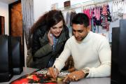 IN TOWN: Amir Khan signs an autograph for Iqra Iqbal during a visit to Petit Fashion in Blackburn on Saturday morning