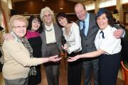 SMILES: Kate Hollern and Brian Taylor with guests at the over-50s get together in Darwen