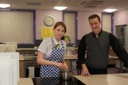 COOKING: Teacher Richard Clegg with student Natalia Wiewiorka