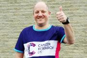 MISSION: Paul Finch is doing the London Marathon to raise funds for Cancer Research UK after losing his wife Patsy, below